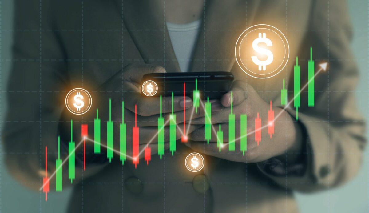 Chartverlauf mit Dollarcoins im Vordergrund